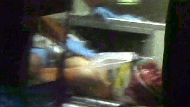 This still frame from video shows Boston Marathon bombing suspect Dzhokhar Tsarnaev visible through an ambulance after he was captured in Watertown, Mass., Friday, April 19, 2013. A 19-year-old college student wanted in the Boston Marathon bombings was taken into custody Friday evening after a manhunt that left the city virtually paralyzed and his older brother and accomplice dead.  (AP Photo/Robert Ray)