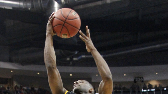 Southern Mississippi's LaShay Page (0) goes in to score behind Kansas State's Jamar Samuels (32) in the first half of an East Regional NCAA tournament second-round college basketball game on Thursday, March 15, 2012, in Pittsburgh. (AP Photo/Keith Srakocic)