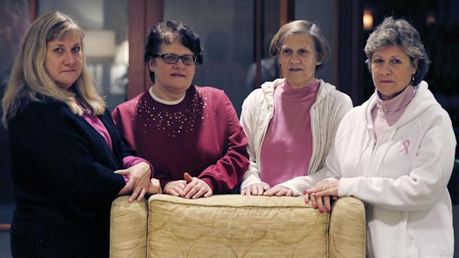 The Melnick sisters, who are suing Eli Lilly and Co. alleging that a synthetic estrogen known as DES caused them all to get breast cancer, pose at their hotel in Boston, Monday evening, Jan. 7, 2013. Testimony is set to begin in their federal lawsuit against the drug maker on Tuesday Jan. 8th. From left are Francine Melnick, Andrea Andrews, Donna McNeely and Michele Fecho. (AP Photo/Charles Krupa)