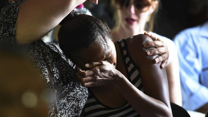 A woman reacts during church service for eight children who were killed in Cairns suburb of Manoora