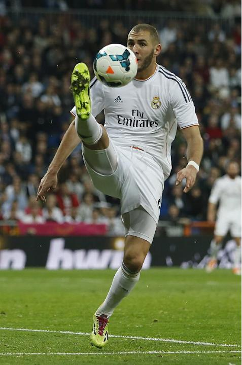 Real's Karim Benzema from France controls the ball during a Spanish La Liga soccer match between Real Madrid and Levante at the Santiago Bernabeu stadium in Madrid, Spain, Sunday March 9, 2014