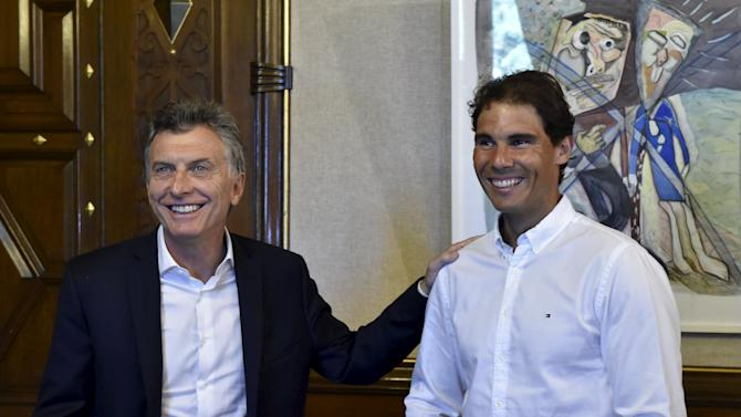 Argentina's President Macri smiles next to Spain's tennis player Nadal during a meeting at the Casa Rosada Presidential Palace in Buenos Aires