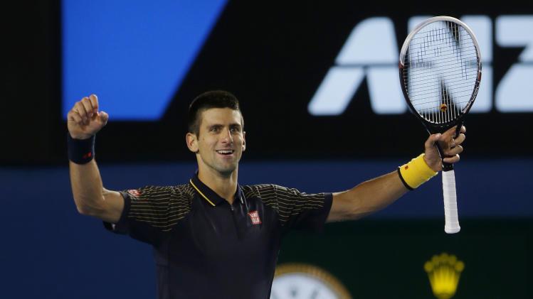 Serbia's Novak Djokovic celebrates his win over Britain's Andy Murray in the men's final at the Australian Open tennis championship in Melbourne, Australia, Sunday, Jan. 27, 2013. (AP Photo/Dita Alangkara)