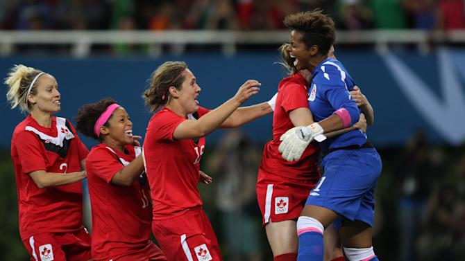 Canada's players celebrate at the end of the women's soccer gold medal match against Brazil at the Pan American Games in Guadalajara, Mexico, Thursday, Oct. 27, 2011. Canada won 4-3 on penalty kicks.  (AP Photo/Juan Karita)