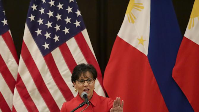 """U.S. Secretary of Commerce Penny Pritzker addresses the American Chamber of Commerce and Filipino businessmen Wednesday, June 4, 2014 at the financial district of Makati city east of Manila, Philippines. Pritzker told American and Filipino business groups Wednesday that the United States has overinvested its diplomatic, economic and strategic resources in other parts of the world. She said it was committed to policies """"to correct the imbalance and to deepen U.S. engagement"""" with Asia. (AP Photo/Bullit Marquez)"""
