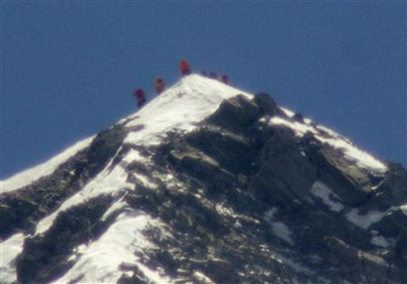 A team of climbers including 80-year-old Japanese mountaineer Yuichiro Miura stand on the summit of Mount Everest