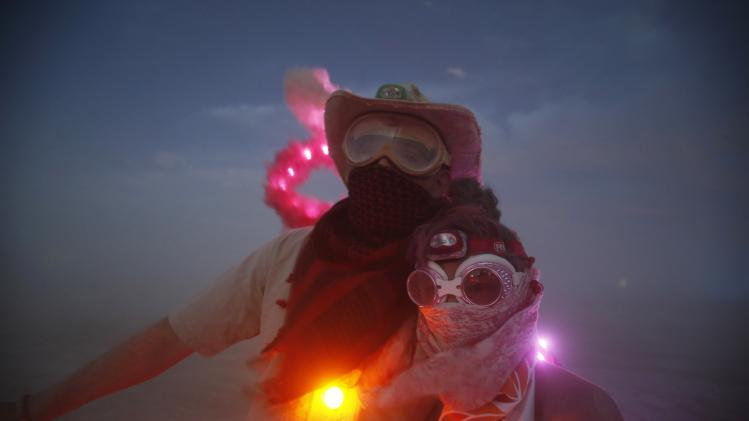 "Wade Harrell and his wife Heather Harrell geared up for the dust during the Burning Man 2014 ""Caravansary"" arts and music festival in the Black Rock Desert of Nevada"