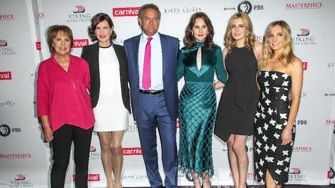 From left, Penelope Wilton, Elizabeth McGovern, Hugh Bonneville, Michelle Dockery, Laura Carmichael and Joanne Froggatt attend the 'Downton Abbey' cast photo call during the 2015 Summer TCA Tour at The Beverly Hilton Hotel on Saturday, Aug. 1, 2015, in Beverly Hills, Calif. (Photo by Paul A. Hebert/Invision/AP)