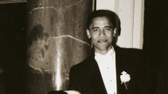 FILE - In this Oct. 18, 1992, photo released by Obama for America campaign shows Democratic presidential candidate Barack Obama and his bride Michelle Robinson on their wedding day in Chicago. She is 5-foot-11, and she is world-famous. Sometimes she inspires awe in her admirers. She has been accused of being the angry type. So when Michelle Obama meets people, she likes to bring things down to earth with a hug.  (AP Photo/Obama for America)