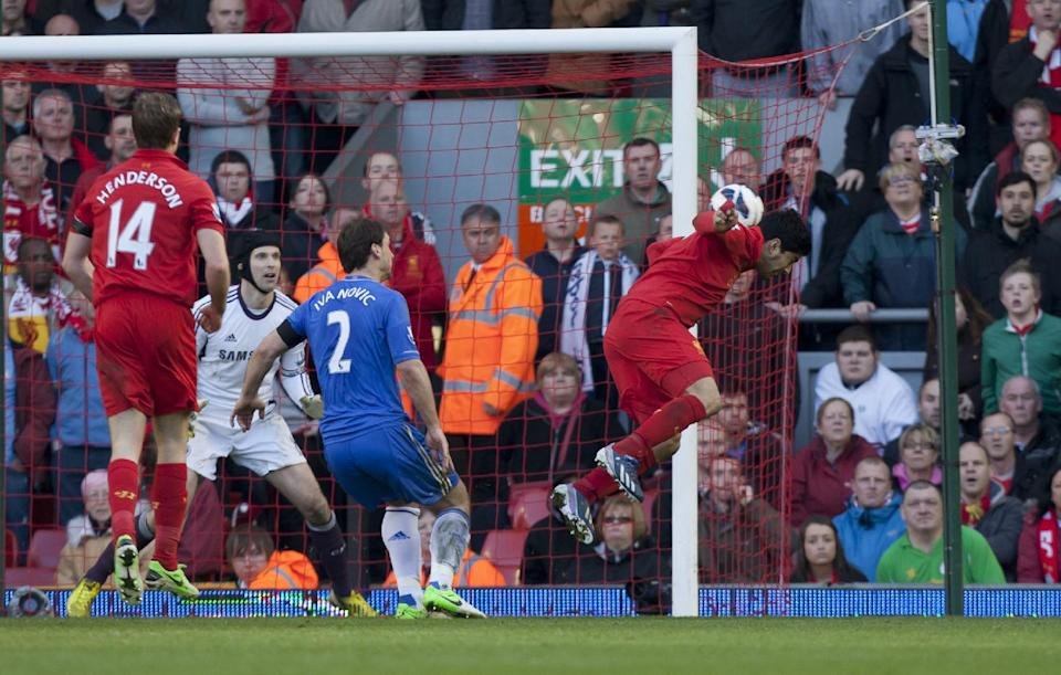 Liverpool's Luis Suarez, right, scores against Chelsea during their English Premier League soccer match at Anfield Stadium, Liverpool, England, Sunday April 21, 2013. (AP Photo/Jon Super)
