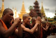Rakhine Buddhist monks pray in Langon, Myanmar in June 2012. Several thousand monks took to the streets of Mandalay, the country&#39;s largest city, Friday to protest against a world Islamic body&#39;s efforts to help Muslim Rohingya in strife-hit Rakhine state, organisers said