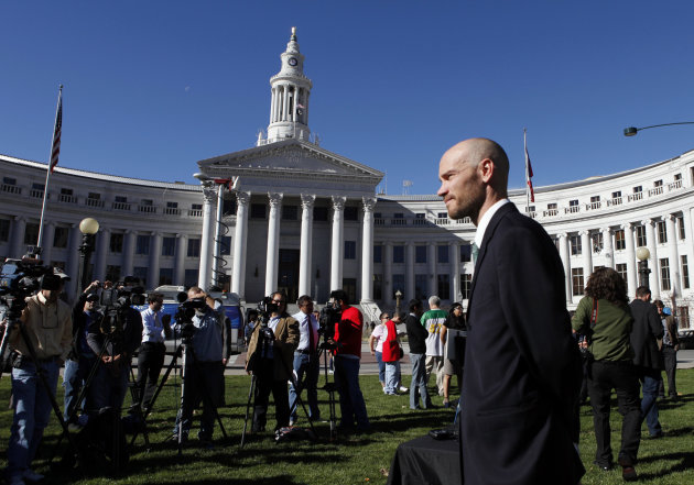 Brian Vicente co-director of the Yes on 64 campaign waits to start a news conference about the legalization of marijuana at Civic Center Park in Denver on Wednesday, Nov. 7, 2012.  Colorado voters pas