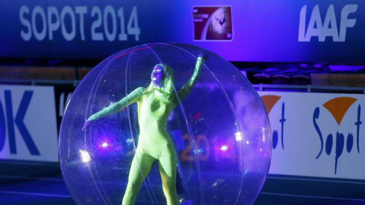 A performer takes part during opening ceremony for the world indoor athletics championships in Sopot