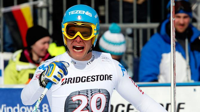 Italy's Christof Innerhofer celebrates after winning an alpine ski, men's World Cup downhill race, in Garmisch Partenkirchen, Germany, Saturday, Feb. 23, 2013. (AP Photo/Alessandro Trovati)