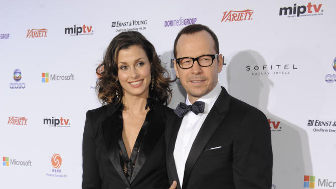 """Bridget Moynihan, left, and Donnie Wahlberg of the CBS series """"Blue Bloods,"""" arrive for the 40th International Emmy Awards,  Monday, Nov. 19, 2012 in New York.  (AP Photo/Henny Ray Abrams)"""