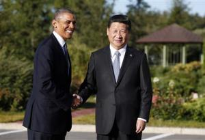 U.S. President Barack Obama shakes hands as he meets with China's President Xi Jinping at the G20 Summit in St. Petersburg