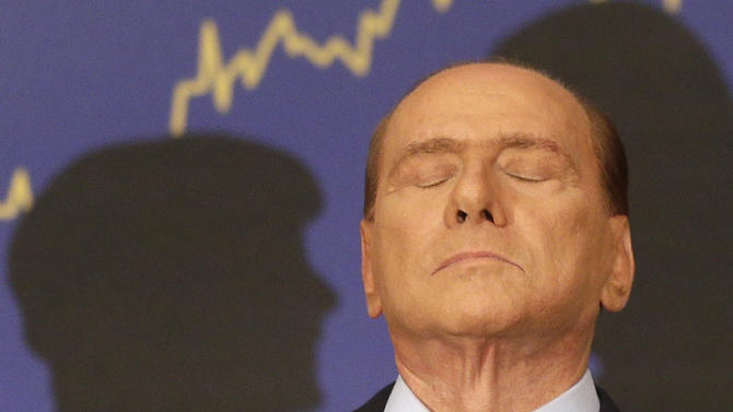 FILE - In this Sept. 27, 2012 file photo, Italian former premier Silvio Berlusconi reacts during a press conference in Rome, Italy. A court in Italy has convicted, Friday, Oct. 26, 2012, former Premier Silvio Berlusconi of tax fraud and sentenced him to four years in prison. In Italy, cases must pass two levels of appeal before the verdicts are final. Berlusconi is expected to appeal. (AP Photo/Alessandra Tarantino, File)