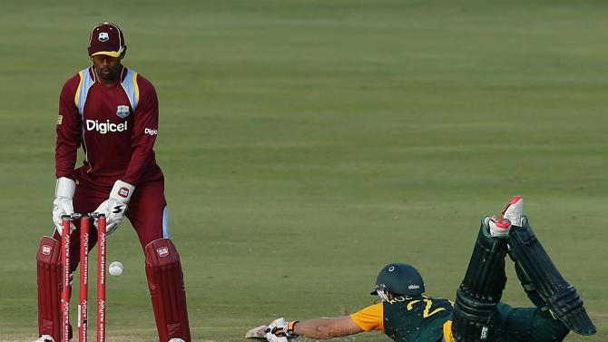 South Africa's Rossouw avoids being run out as West Indies' wicketkeeper Ramdin looks on during their fifth One-Day International cricket match in Centurion