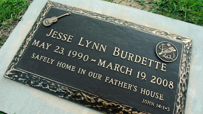 In this July 21, 2011 photo, the grave of 17-year-old Jesse Lynn Burdette is shown in a cemetery in Auburn, Ala. The teenager's mother, Kay Burdette, pleaded guilty to a misdemeanor charge in his death after admitting she prayed for his healing rather than taking him to a doctor. The case was complicated by the state's loss of a key piece of evidence from the autopsy. (AP Photo/Jay Reeves)