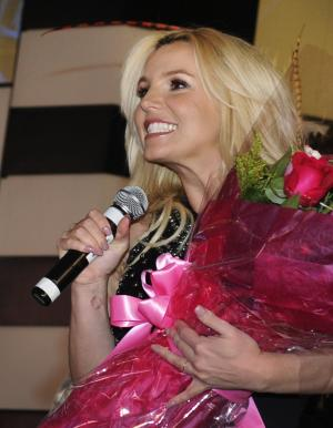 "Singer Britney Spears speaks to the crowd after arriving at Planet Hollywood Resort & Casino before the debut of her new Las Vegas residency ""Britney: Piece of Me"" on Tuesday, Dec. 3, 2013, in Las Vegas. (Photo by David Becker/Invision/AP)"