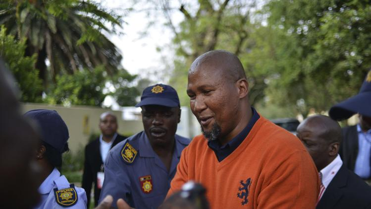 Mandla Mandela greets people outside the home of his late grandfather former President Nelson Mandela in Johannesburg