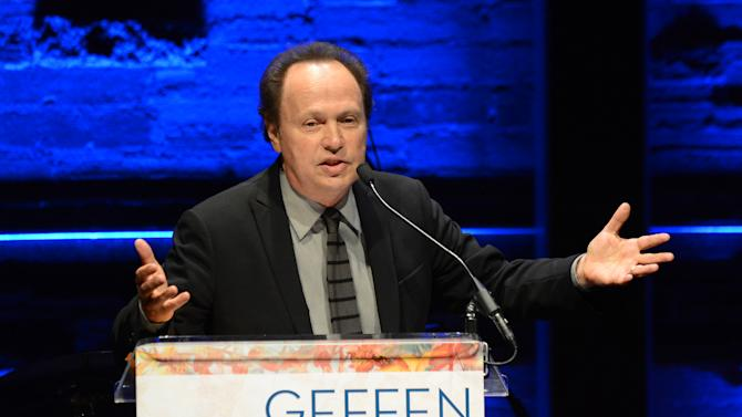 EXCLUSIVE CONTENT - Billy Crystal accepts the distinction in theatre award during the Backstage at the Geffen gala at the Geffen Playhouse on Monday, May 13, 2013, in Los Angeles. (Photo by Jordan Strauss/Invision for Geffen/AP Images)