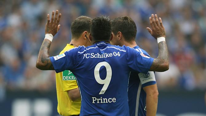 Schalke 04's Boateng reacts to referee Schmidt after a red card during the Bundesliga soccer match against Eintracht Frankfurt in Gelsenkirchen