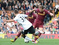 Manchester City's Edin Dzeko (right) scores his side's winner against Fulham