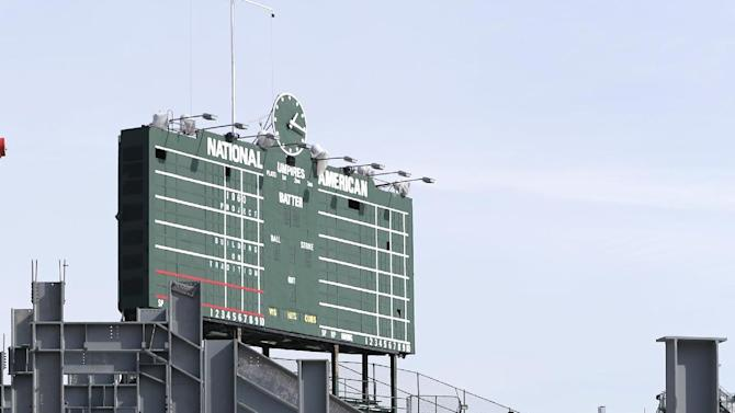 Construction of the left field bleachers and new video board continues while the Chicago Cubs' press forward on renovations to Wrigley Field as opening day approaches Monday, March 2, 2015, in Chicago. The Cubs will be going back to the city asking that the construction to continue around the clock, said Crane Kenney, the Cubs' president of business operations. (AP Photo/Charles Rex Arbogast)