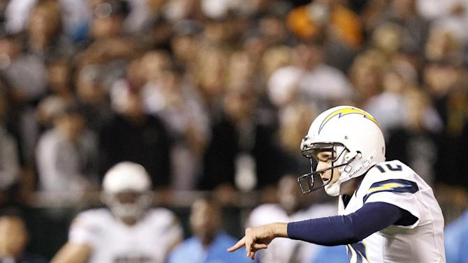 San Diego Chargers kicker Nate Kaeding (10) kicks a field goal from the hold of punter Mike Scifres (5) during the first half of an NFL football game against the Oakland Raiders in Oakland, Calif., Monday, Sept. 10, 2012. The Chargers won 22-14. (AP Photo/Tony Avelar)