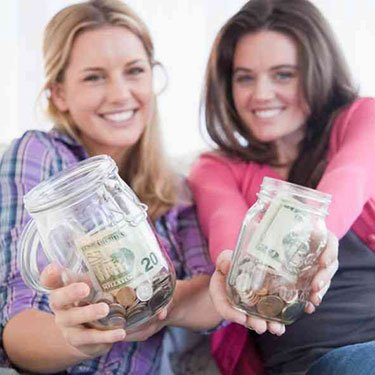 Woman-holding-jars-of-money_web