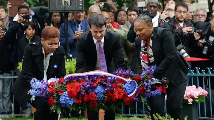 French Prime minister Manuel Valls (C), Overseas territories minister George Pau-Langevin (L) and Justice minister Christiane Taubira (R) during a ceremony marking the end of slavery, on May 10, 2014, in Paris