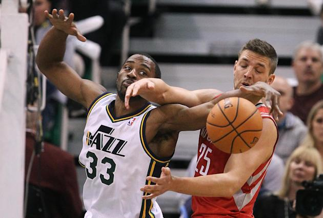 Utah Jazz's Mike Harris (33) and Houston Rockets' Chandler Parsons (25) battle for a rebound in the second half during an NBA basketball game Saturday, Nov. 2, 2013, in Salt Lake City. The Rockets def