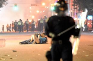 Scott Jones and Alexandra Thomas got caught up in the moment as rioting mobs filled the Vancouver streets after the Vancouver Canucks lost to the Boston Bruins in the Stanley Cup finals on June 15.(Photo: Rich Lam/Getty Images)