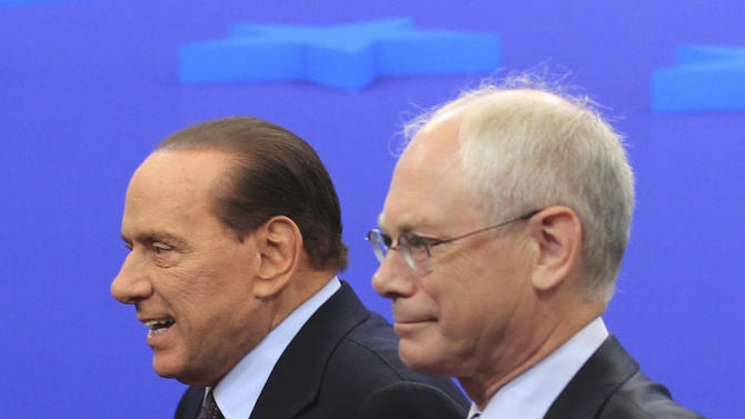 European Council President, Herman Van Rompuy, right, and Italy's Prime Minister, Silvio Berlusconi, walk to their meeting at the European Council building in Brussels, Tuesday, Sept. 13, 2011. (AP Photo/Yves Logghe)