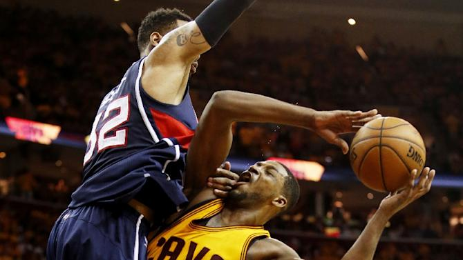 Mike Scott (L) of the Atlanta Hawks defends against Tristan Thompson of the Cleveland Cavaliers in overtime during Game Three of the Eastern Conference Finals at Quicken Loans Arena on May 24, 2015