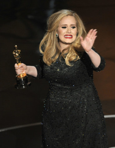 Singer Adele accepts the award for best original song for &quot;Skyfall&quot; from the film &quot;Skyfall&quot; during the Oscars at the Dolby Theatre on Sunday Feb. 24, 2013, in Los Angeles. (Photo by Chris Pizzello/Invision/AP)