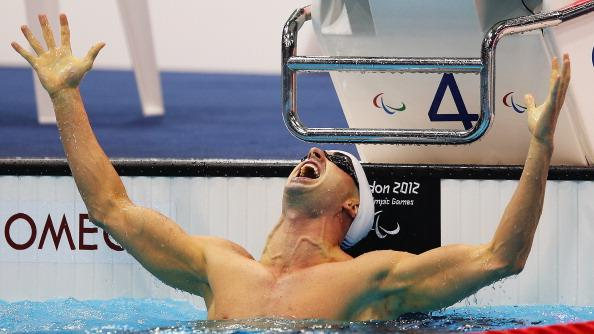 Benoit Huot of Canada celebrates winning the gold in the Men's 200m Individual Medley - SM10 final on day 1 of the London 2012 Paralympic Games at Aquatics Centre on August 30, 2012 in London, England. (Photo by Hannah Johnston/Getty Images)