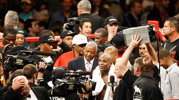 Floyd Mayweather is interviewed after a win. (Photo credit: Craig Bennett/112575 Media Inc)