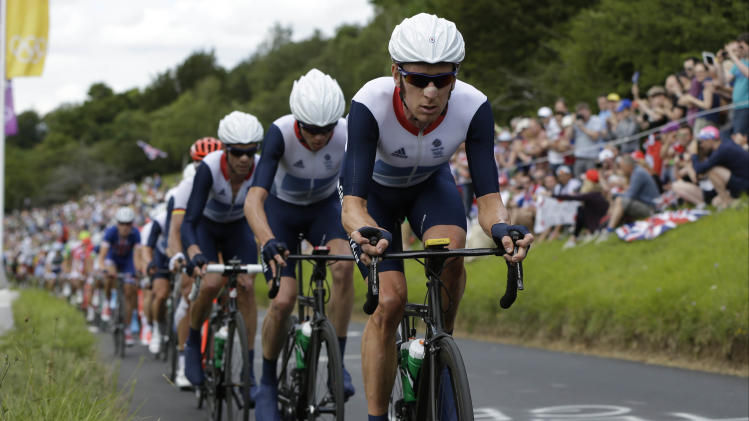 Bradley Wiggins leads his teammates and the rest of the pack during the Men's Road Cycling race at the 2012 Summer Olympics, Saturday, July 28, 2012, in London. Alexander Vinokourov of Kazakhstan won the gold medal as Rigoberto Uran of Colombia took silver, and Alexander Kristoff of Norway claiming the bronze medal. (AP Photo/Lefteris Pitarakis)