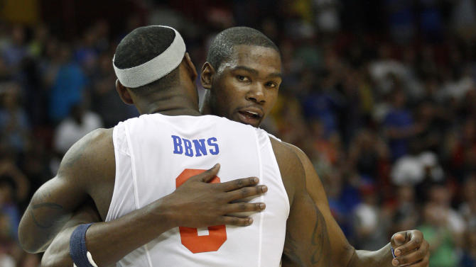 Oklahoma City Thunder forward Kevin Durant, rear, and Miami Heat forward LeBron James greet each other following an NBA charity basketball invitational game, in Oklahoma City, Sunday, Oct. 23, 2011. The game was the latest in a series of exhibition games across the country as NBA players stay in the spotlight while locked out by the league. (AP Photo/Sue Ogrocki)