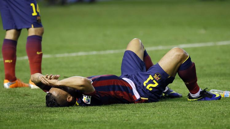 Barcelona's Adriano Correia reacts after losing to Real Madrid at the end of their King's Cup final soccer match in Valencia