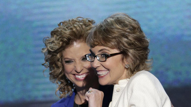 Former Rep. Gabrielle Giffords reacts after reciting the Pledge of Allegiance with Democratic National Committee Chairwoman Rep. Debbie Wasserman Schultz of Florida at the Democratic National Convention in Charlotte, N.C., on Thursday, Sept. 6, 2012. (AP Photo/J. Scott Applewhite)