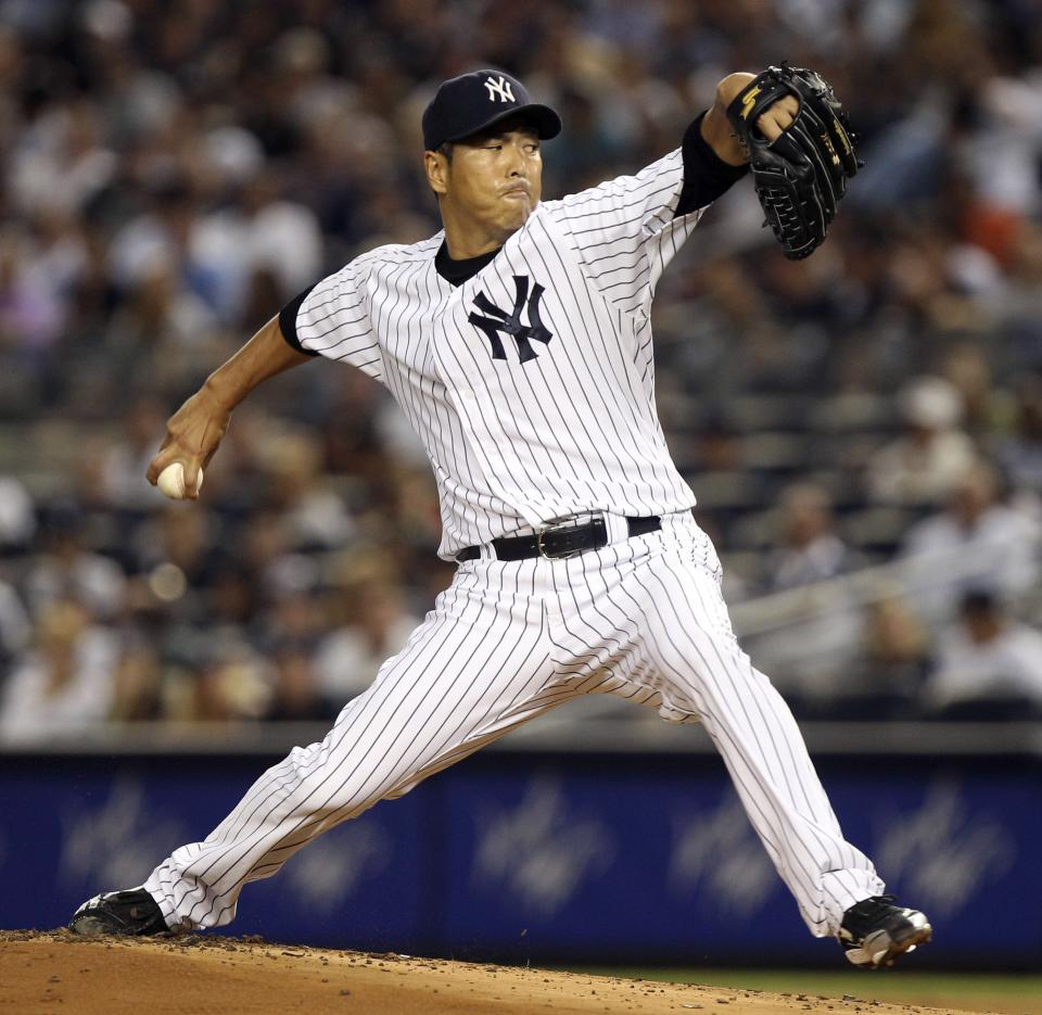 New York Yankees' Hiroki Kuroda pitches during the second inning of a baseball game against the Boston Red Sox at Yankee Stadium in New York, Sunday, July 29, 2012. (AP Photo/Seth Wenig)