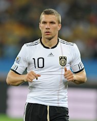 Germany and Arsenal forward Lukas Podolski netted two against former club Cologne