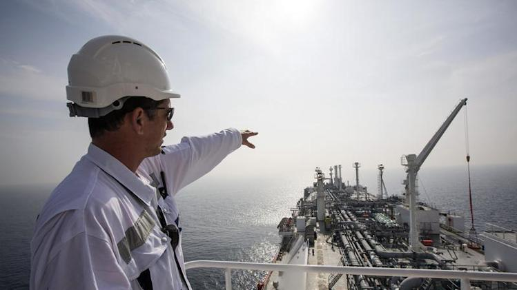 An officer points as he stands on a tanker carrying liquefied natural gas in the Mediterranean, some 10 kilometers from Hadera