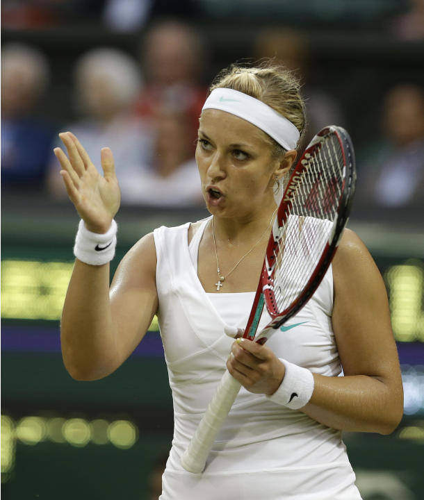 Sabine Lisicki of Germany reacts during a quarterfinals match against Angelique Kerber of Germany at the All England Lawn Tennis Championships at Wimbledon, England, Tuesday, July 3, 2012. (AP Photo/A