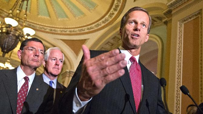 Sen. John Thune, R-S.D., right, speaks to reporters on Capitol Hill in Washington, Tuesday, July 31, 2012, following a GOP political strategy session. from left are, Sen. John Barrasso, R-Wyo., Sen. John Cornyn, R-Texas and Thune.      (AP Photo/J. Scott Applewhite)