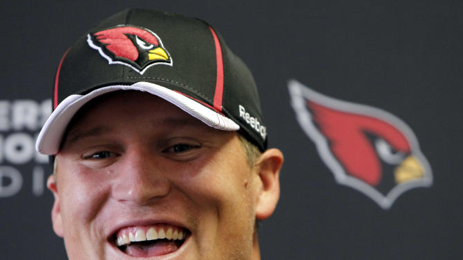 New Arizona Cardinals'  Todd Heap smiles as he talks to the media during a news conference Tuesday, Aug. 2, 2011, in Flagstaff, Ariz. (AP Photo/Ross D. Franklin)