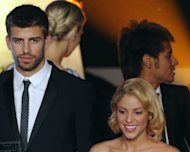 Barcelona defender Gerard Pique (L) arrives with his companion, Colombian singer Shakira (R), on January 9, 2012 for the FIFA Ballon d&#39;Or award at the Kongresshaus in Zurich. Pique irked much the world&#39;s media Friday by announcing his girlfriend Shakira had given birth -- but then revealing it was a prank